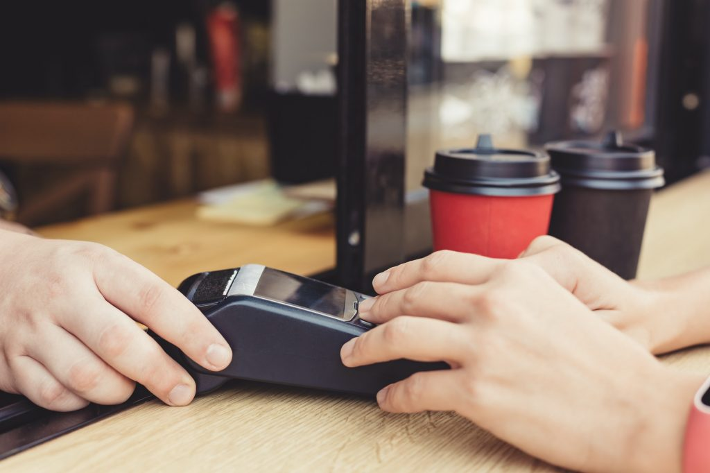 Person using pos terminal at the cafe